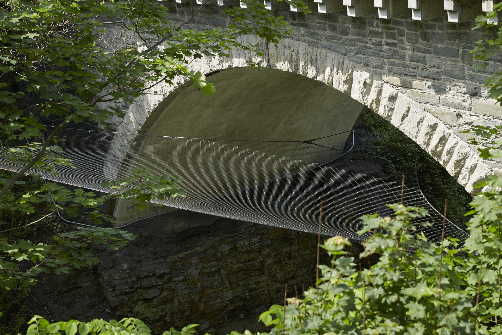 historic bridge over river with safety net
