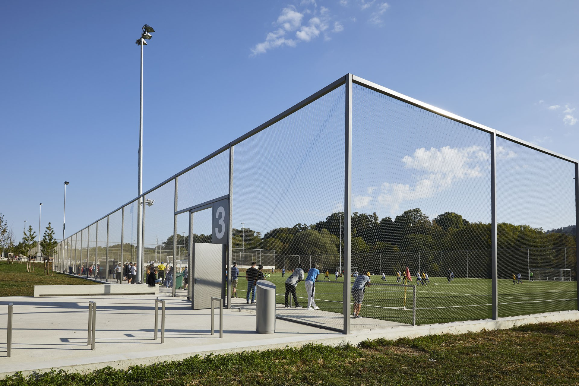ball stop fence at a football field with nearly transparent mesh