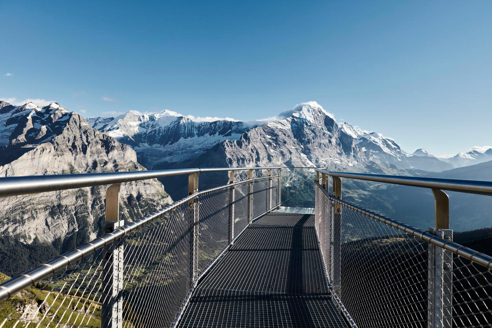 View of the mountains and the Jakob Rope Systems Webnet bridge in Grindelwald
