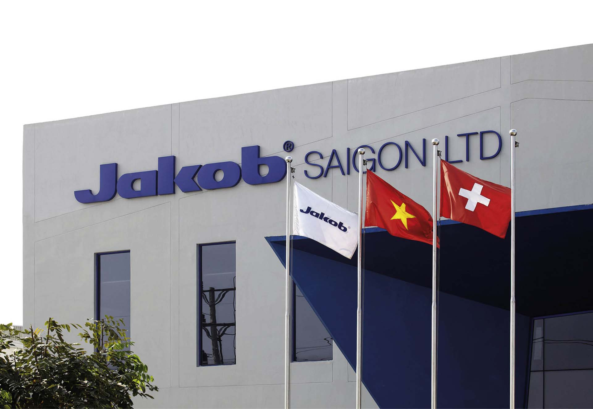 Image of Jakob Saigon factory in 2008 with the flags of Jakob, Vietnam and Switzerland