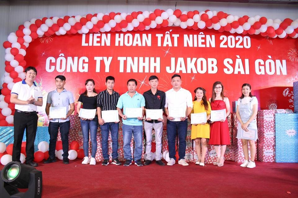 Jakob Saigon employees on stage receiving awards for their 10 years jubilee