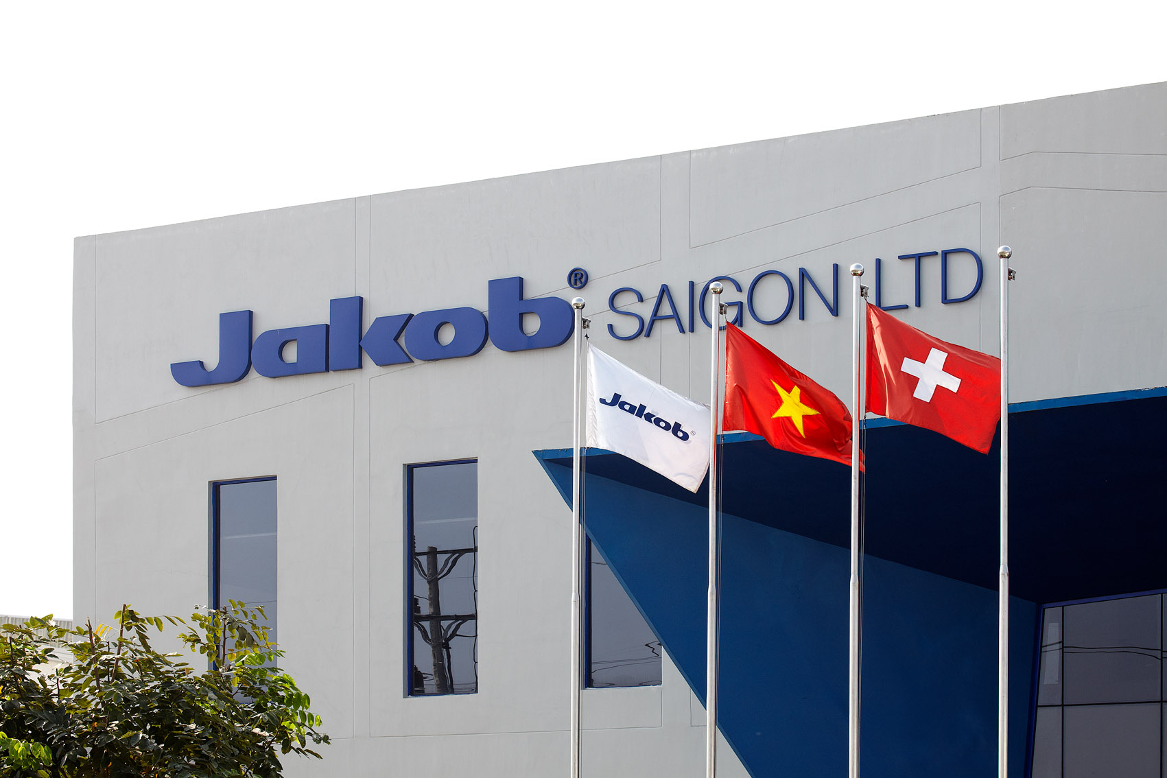The facade of Jakob Saigon in 2008 with the three flags of Jakob Rope Systems, Vietnam and Switzerland