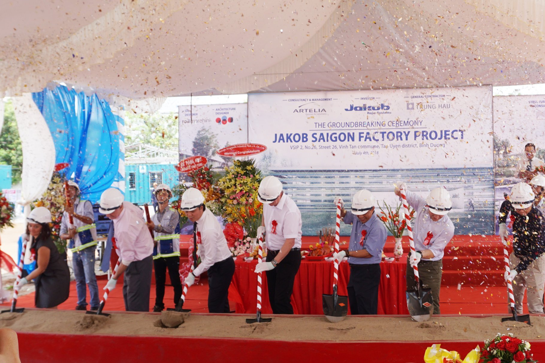 People on stage at the symbolic groundbreaking ceremony of Jakob Saigon in the VSIP II business park