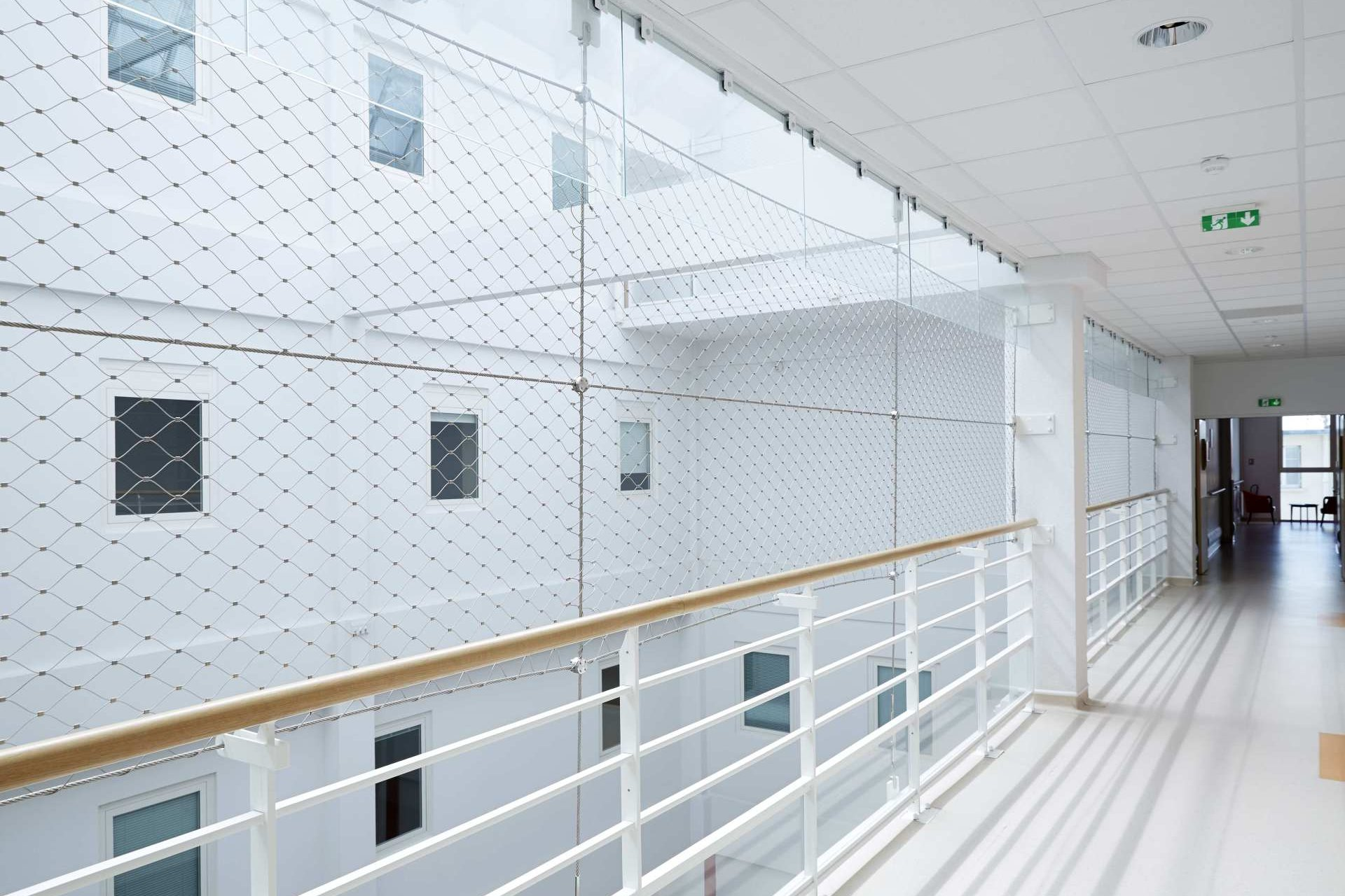 A Webnet security mesh on top of a balustrade in the rehab centre l'adapt in Châtillon, France